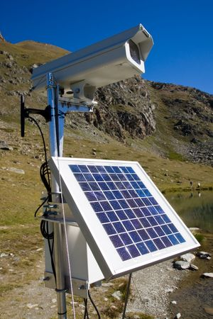 Solarpanel and webcam in the alps photo