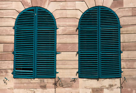 Old windows with green shutters Stock Photo - 8109721