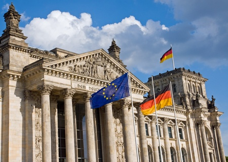 Reichstag in Berlin with German and European flag photo