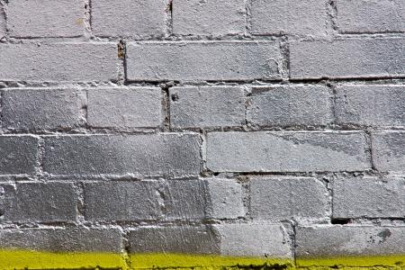 Silver painted graffiti brickwall
