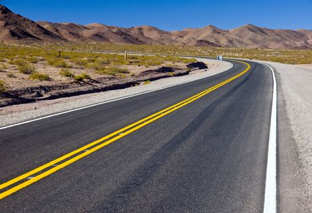 road marking: Winding road in northern Argentina Stock Photo