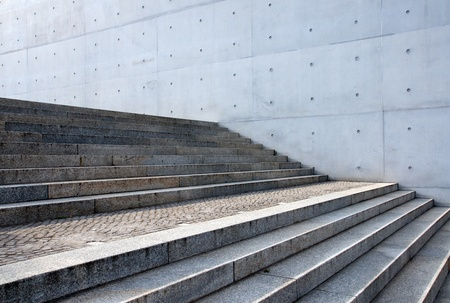 Grey stairs in front of a wall photo
