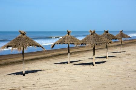 sunshades: Sunshades at an empty beach