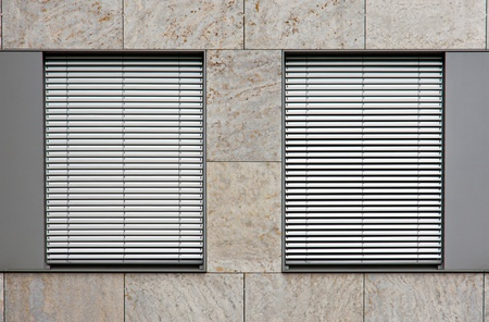 Two windows with shutters photo