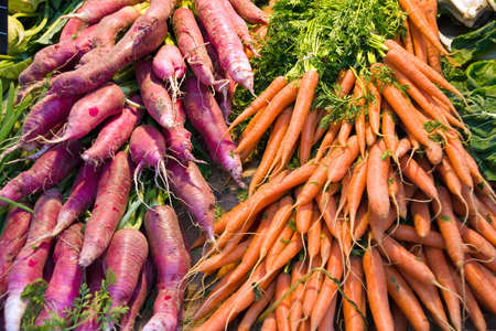 Radish and Carrots for sell on a market photo