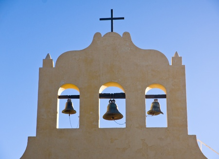 colonization: Three bells and a cross Stock Photo