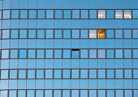 front facing: Facade of an office building with one open window Editorial