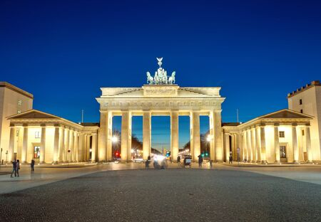 The illuminated Brandenburg Gate at dawn
