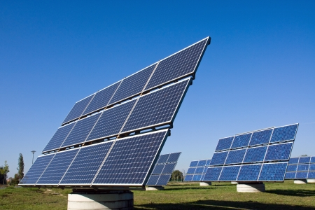 greenhouse effect: Solar energy panels on a meadow Stock Photo