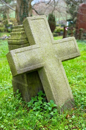 Cross on a cemetary Stock Photo