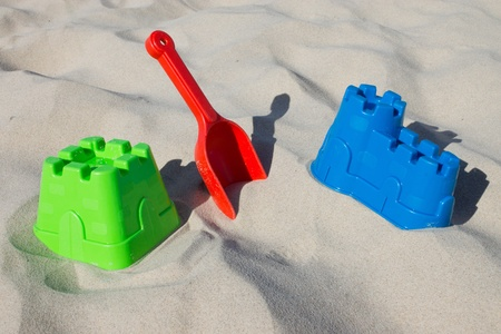 Sandcastle and shovel at the beach photo