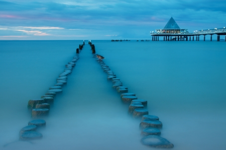 reprimanding: Old and new pier at dusk