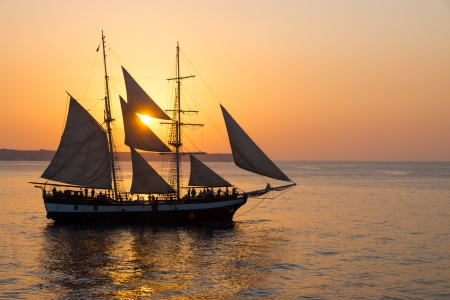 santorini: Sailing ship at sunset