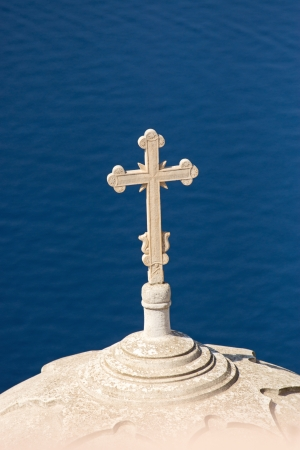 Cross high up over the sea photo