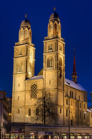 The famous Grossmunster church in Zurich at night photo