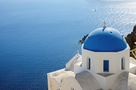 Church with blue cupola in Oia Stock Photo