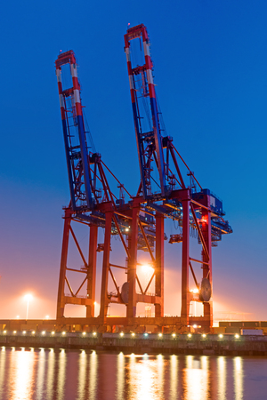 Two container cranes Stock Photo