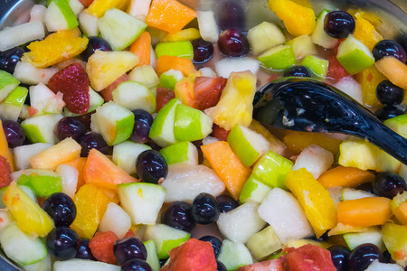 Colourful fresh fruit salad seen in a supermarket photo