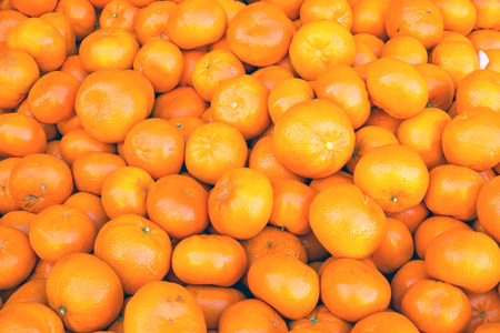 A pile of clementines for sale at a market Stock Photo - 27502755