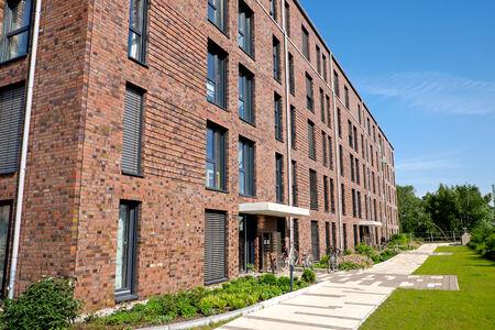 gentrification: Modern red brick buildings Editorial