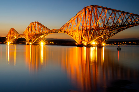 The Forth rail bridge illuminated at dawn photo