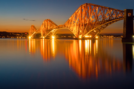 The illuminated Forth rail bridge in Scotland Stock Photo