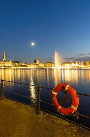 lifesaver: Lifesaver in front of downtown Hamburg at dawn