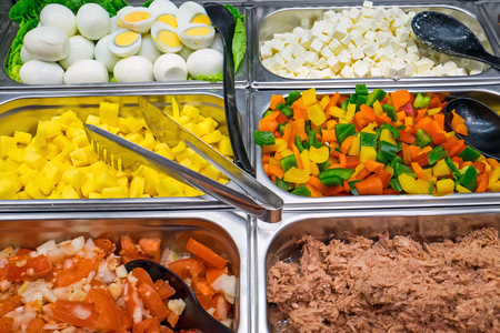 Salad buffet with a lot of choice seen in a restaurant photo