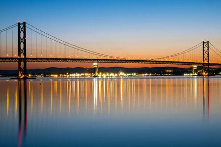 The Forth Road Bridge in Scotland at dawn photo