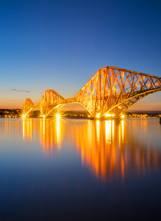 The red Forth Rail Bridge in Scotland at night photo