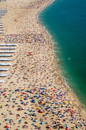 Lots of people at the beach in Nazare, Portugal