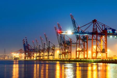 Container cranes in Hamburg harbor at night