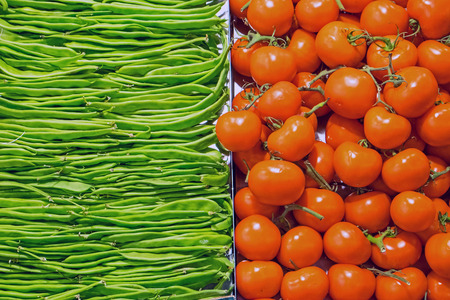 Background from red tomatoes and green peas photo