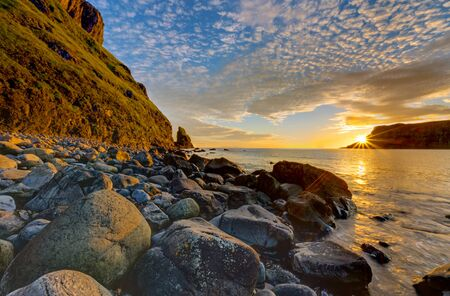 nger: The Talisker Bay on the Isle of Skye in Scotland at sunset