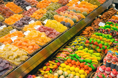 sugarcoat: Market stall with sweets at the Boqueria in Barcelona