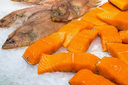 plaice: Salmon and plaice for sale at the Boqueria in Barcelona