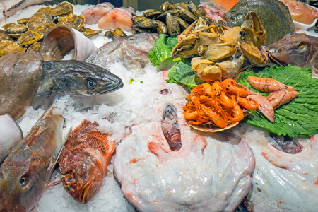 A variety of fish and seafood for sale at the Boqueria in Barcelona photo