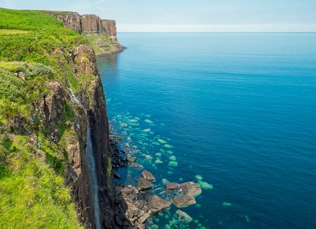 Waterfall and kilt rock on the Isle of Skye in Scotland Imagens
