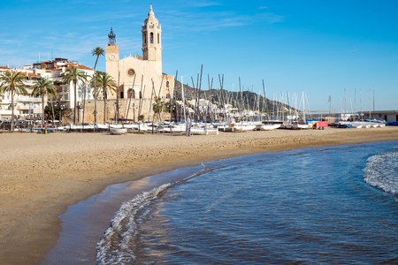 The church and the beach in Sitges, a small town near Barcelona Stock Photo - 38916395