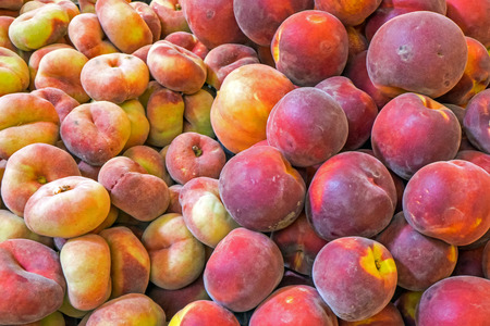 close p: Different kinds of peaches for sale at a market Stock Photo