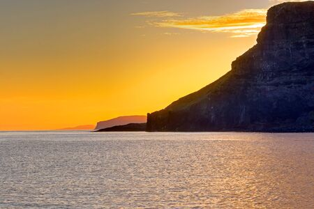 A beautiful sunset seen at the west coast of the Isle of Skye in Scotland Imagens