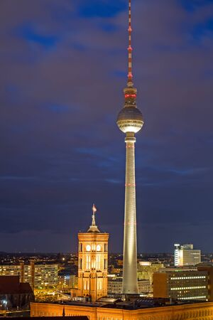 townhall: The famous TV Tower and the red townhall in Berlin at night Editorial