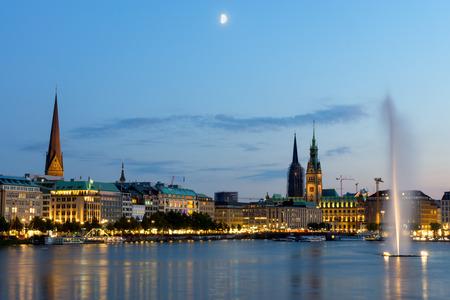 Hamburg39s landmarks and the Inner Alster lake at dawn