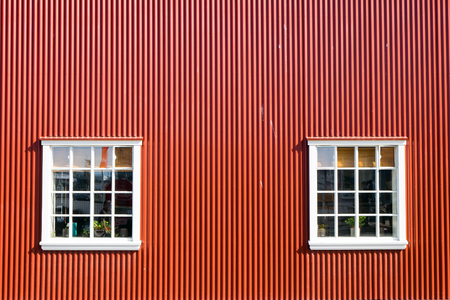 Reykjavik: Red wall and two windows seen in Reykjavik, Icleand