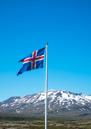icelandic flag: Icelandic flag waving in front of some mountains