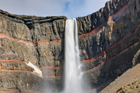 strata: The Hengifoss waterfall in Iceland with the red stripes Strata