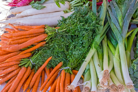 herbage: Carrots, leeks and herbage for sale at a market Stock Photo