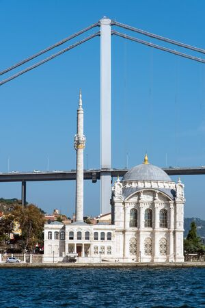 colum: The Ortakoy Mosque and the first Bosphorus bridge in Istanbul, Turkey