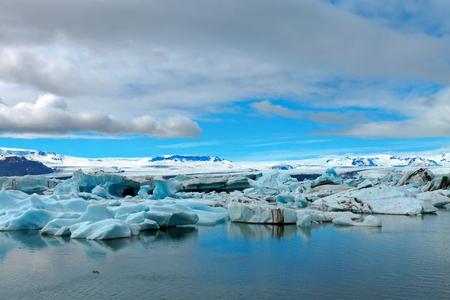 winter sky: Icebergs at the glacier lagoon Jokulsarlon in Iceland
