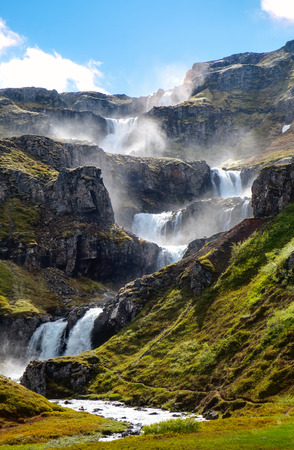 The cascades of the waterfall in Iceland Klifbrekkufossar